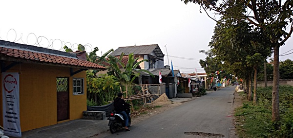 Front gate, day, view toward Bogor