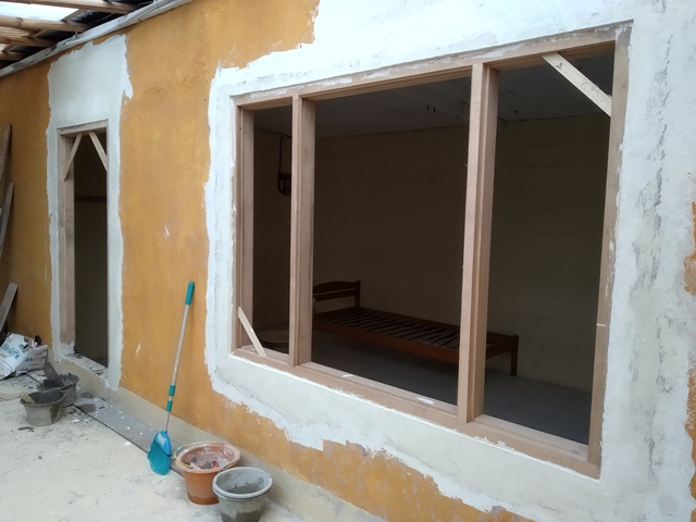 The big window frame and door frame in the Pool room